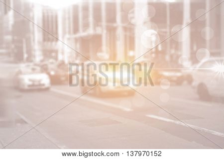 City street with cars and bright light and lensflares