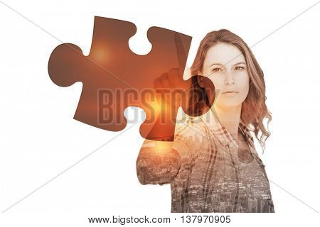 Concentrated pretty hipster pointing against jigsaw piece