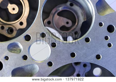 Helicopter engine detail with round holes, air force, modern aviation and aerospace industry, abstraction