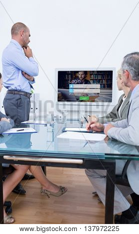Business team looking at white screen against login screen with hipster in library and laptop