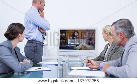 Business team looking at white screen against login screen superimposed on hipster man with laptop