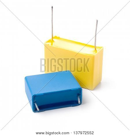 Two film capacitors isolated on white background.