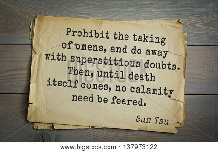Ancient chinese philosopher Sun Tzu quote on old paper background. Prohibit the taking of omens, and do away with superstitious doubts. Then, until death itself comes, no calamity need be feared.