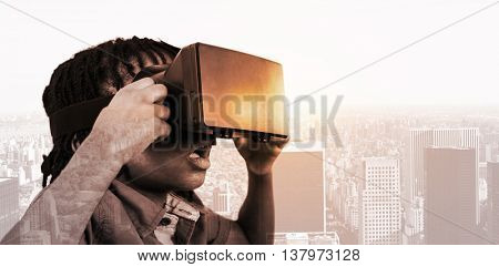 Profile view of little boy holding virtual glasses against new york