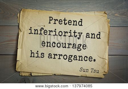 Ancient chinese strategist and philosopher Sun Tzu quote on old paper background. Pretend inferiority and encourage his arrogance.