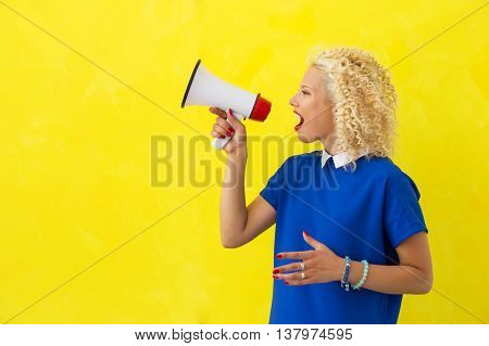 Woman speaking in megaphone in a loud voice