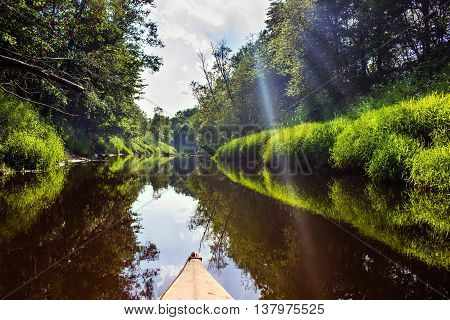 The forest river in the sun light, first-person from kayak Luchosa, Belarus.