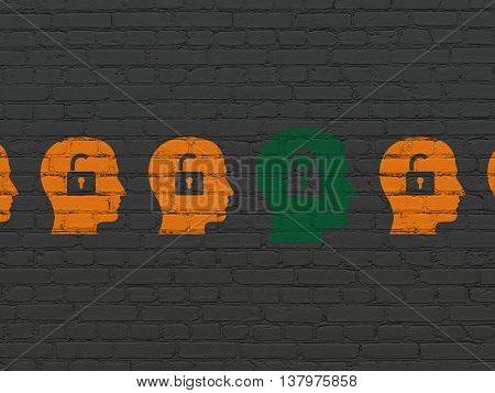 Safety concept: row of Painted orange head with padlock icons around green head with padlock icon on Black Brick wall background