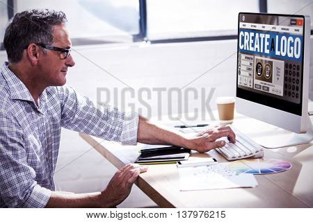 Webpage for create a logo against profile view of a businessman working on computer