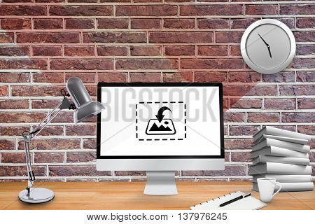 Image of a virtual desk against red brick wall