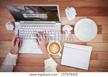 Login screen with blonde woman against cropped image of woman with pen using laptop