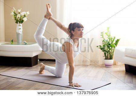 Pregnant Woman Doing Bird-dog Yoga Pose At Home