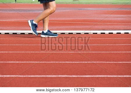 Man walking on track at Sport Stadium