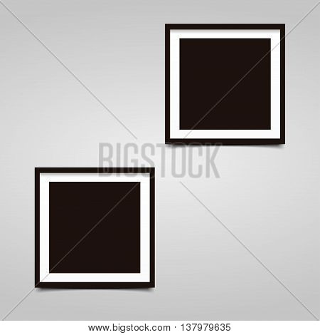 Two square photo frame with shadow on a gray background