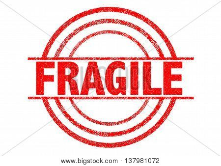 FRAGILE red Rubber Stamp over a white background.