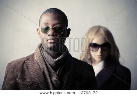 Elegant african man with mannequin on the background