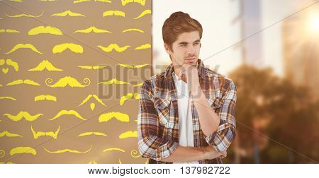 Confident businessman standing with hand on chin against composite image of mustaches