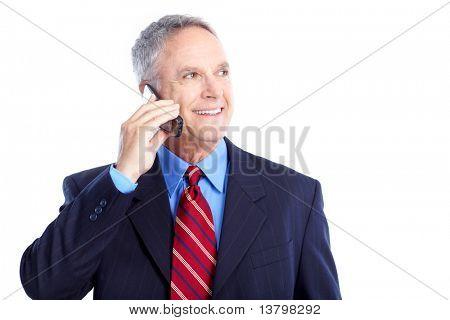 Smiling handsome businessman talking by cellular