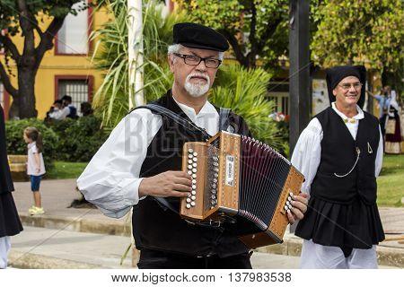 SELARGIUS, ITALY - September 13, 2015: Former marriage Selargino - Sardinia - accordionist of the folk group pro-loco of Gonnosfanadiga