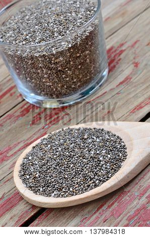 Wooden spoon with chia seeds on table