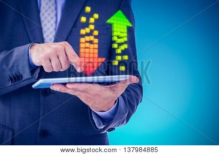 Businessman using tablet pc against blue vignette background