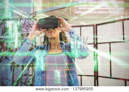 Green and red lines next to screens against low angle view of executive enjoying virtual reality headset at creative office
