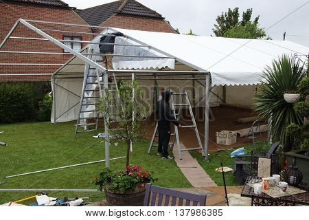 2ND JULY 2016,PORTSMOUTH,ENGLAND: Building a marquee in a garden for a wedding in portsmouth,england, 2nd july 2016