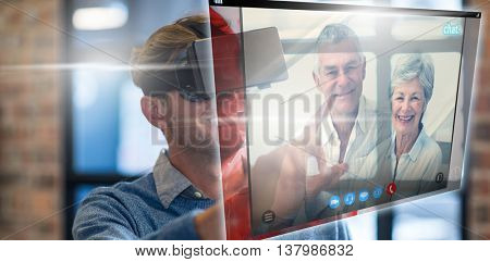 Screen of a video call against businessman using virtual reality headset in office