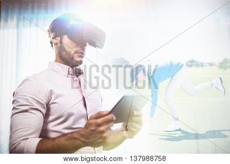 Female golfer picking up golf ball against businessman using an oculus