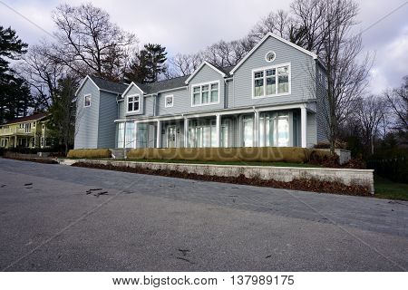 HARBOR SPRINGS, MICHIGAN / UNITED STATES - DECEMBER 25, 2015: A large mansion on East Bluff Drive in Harbor Springs, Michigan, with a view of Little Traverse Bay.