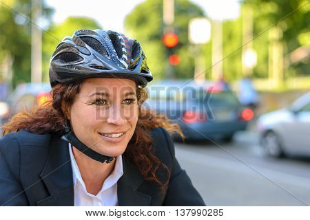 Attractive Businesswoman Commuting On A Bicycle