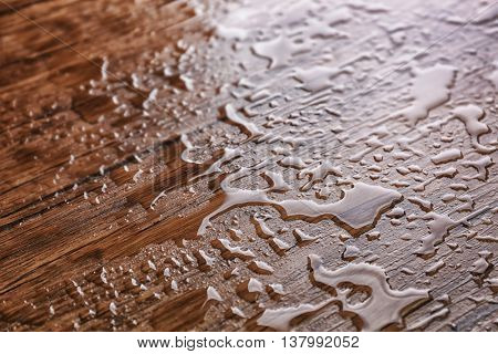 Water drops on wooden background