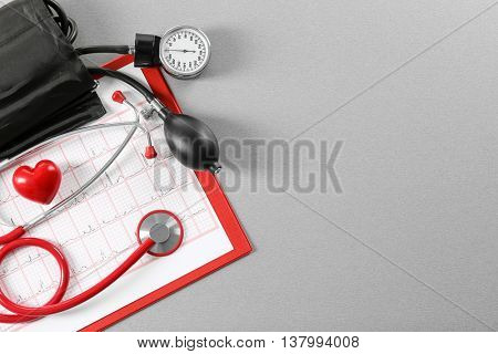 Stethoscope and tonometer on table