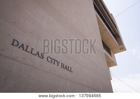 DALLAS, TEXAS-MAY 26 2009: A low angle view of the side of the Dallas City Hall building looking upward on May 26, 2009. The building, an inverted pyramid was designed by I.M. Pei.