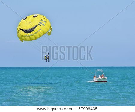 Sochi, Russia - June 24, 2014, Boat parachute carries travelers