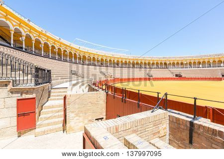 SEVILLE, SPAIN - JUN 4: Bullfight arena, plaza de toros at Sevilla, Spain on June 4, 2014. This is a 12,000-capacity bullring in Seville, Spain.