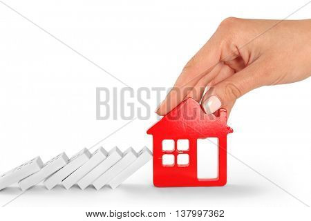 Woman hand with house shape and dominoes, isolated on white