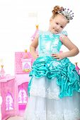 picture of cute little girl  - Beautiful little girl in princess dress playing with her toy castle - JPG
