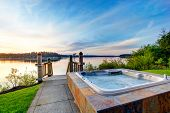 Awesome Water View With Hot Tub At Dusk In Summer Evening. poster