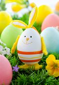 stock photo of easter bunnies  - colorful Easter Eggs and rabbit on the grass - JPG