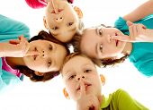 stock photo of shh  - Group of children fingers on lips making silence - JPG