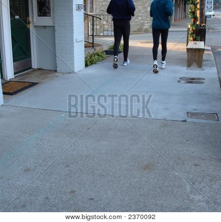 Runners On Sidewalk
