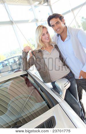 Happy couple holding new car keys