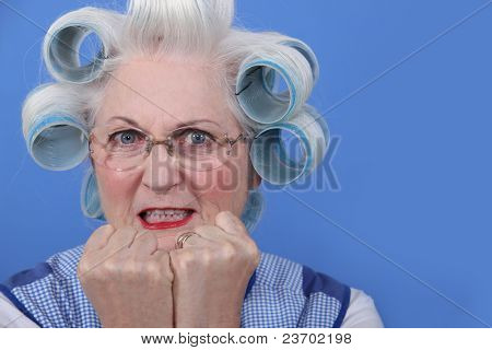 A mature lady with hairroller.