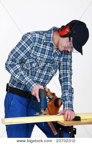 Woodworker using jigsaw