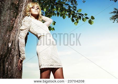 Portrait Of A Young Beautiful Blond Woman In Park