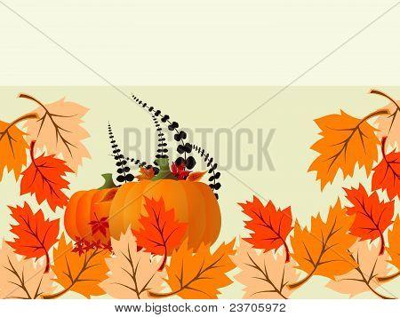 Pumpkin among autumn leaves
