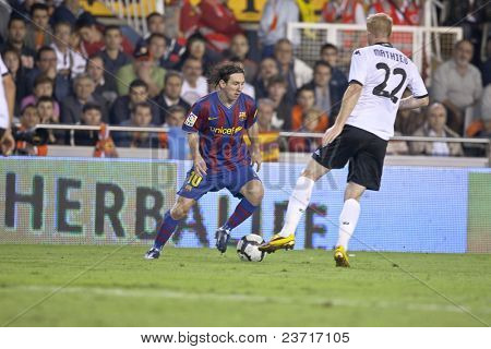 VALENCIA, SPAIN - OCTOBER 17 - Leo Messi - FootBall Match of Spanish Professional Soccer League between Valencia C.F. vs F.C. Barcelona - Mestalla Luis Casanova Stadium on October 17, 2009 in Valencia, Spain