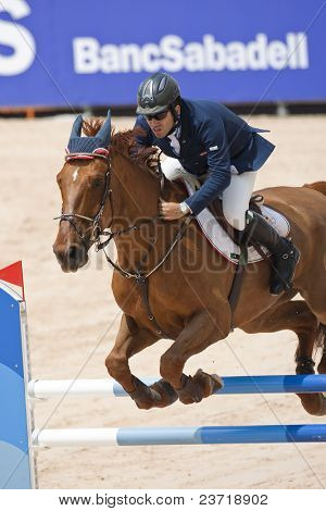 VALENCIA, SPAIN - MAY 7: Rider Guido Grimaldi, Horse Art Nouveau, Italy in the Global Champions Tour Valencia 2010 equestrian - the City of Arts and Sciences of Valencia, Spain on May 7, 2010