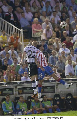 VALENCIA, SPAIN - SEPTEMBER 22 - FootBall Match of Spanish Professional Soccer League between Valencia C.F. vs AT. Madrid - Luis Casanova Stadium - Mathieu, Diego Costa - Spain on September 22, 2010